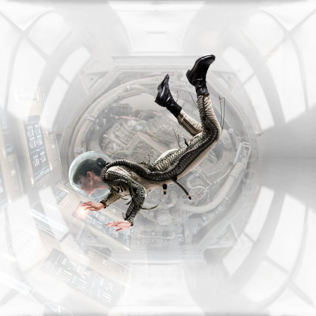 Weightless In Space Station - Female astronaut floating while working in space station